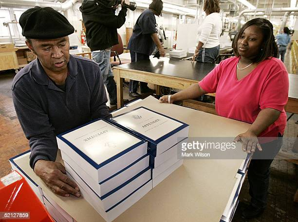 Workers stack copies of the fiscal year 2005 budget at the Government Printing Office February 3 2005 in Washington DC President Bush's 2005 budget...