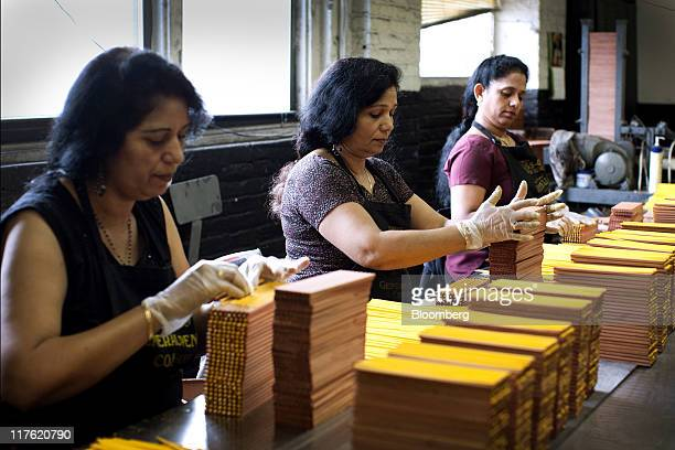 Workers stack pencils for packaging at the General Pencil Co's factory in Jersey City New Jersey US on Wednesday June 22 2011 General Pencil Co...