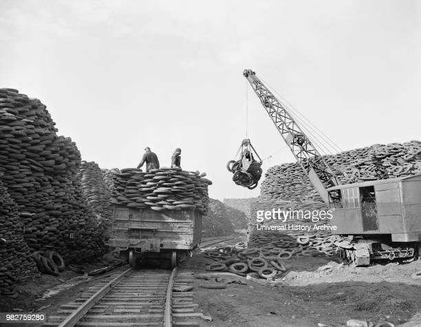 Workers Stacking Discarded Tire Casings at Recovery Plant with the Reclaimed Material to be Manufactured into Thousands of Essential Mechanical...