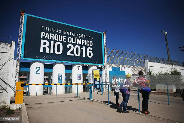 Workers stand at an entrance to the Olympic Park construction site on June 8 2015 in the Barra da Tijuca neighborhood of Rio de Janeiro Brazil...