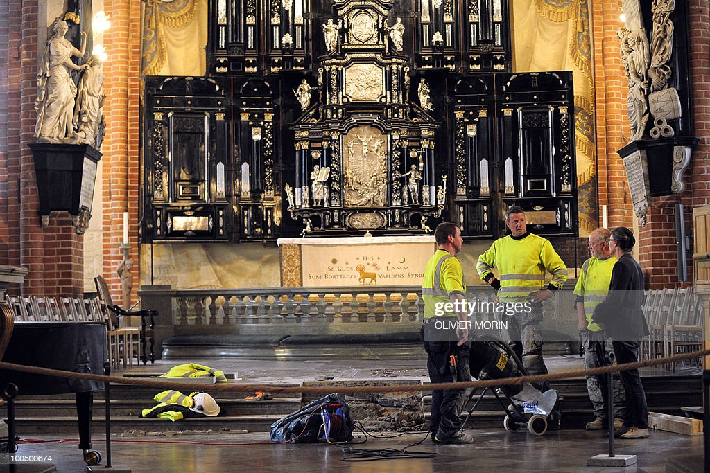 Workers stand by the altar as they carry out renovation works in the Cathedral, known as Storkyrkan, situated near the Royal Castle in Stockholm on May 25, 2010, less than a month before Crown Princess Victoria 's wedding, the 32-year-old eldest daughter of King Carl XVI Gustaf. Tensions with the archbishop, the future prince's health problems and the soaring cost of the festivities are just some of the controversies surrounding the run-up to Swedish Crown Princess Victoria and her husband-to-be Daniel Westling's June 19 wedding.