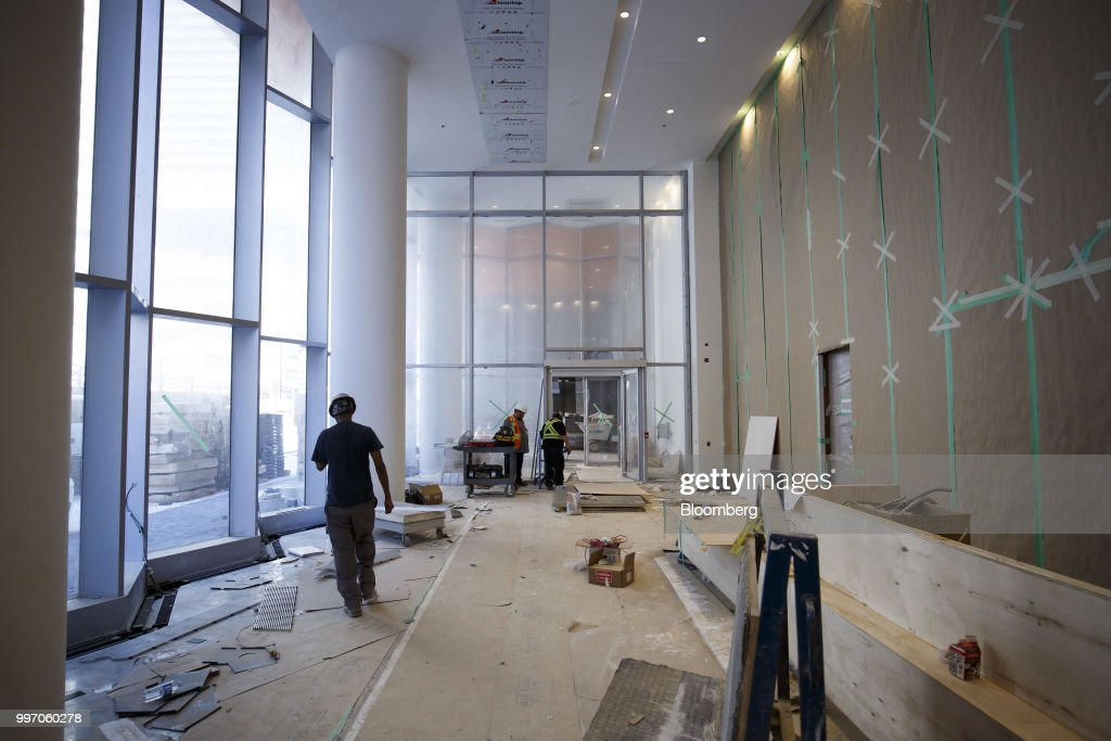 Workers stand in the lobby during construction of the GWL Realty Advisors Livmore luxury apartment building in Toronto, Ontario, Canada, on Tuesday, July 10, 2018. Toronto's rental market is going upscale to meet surging demand from millennials and downsizing baby boomers who want a little more than your average walkup while providing a steady income stream for institutions such as pension funds. Photographer: Cole Burston/Bloomberg via Getty Images