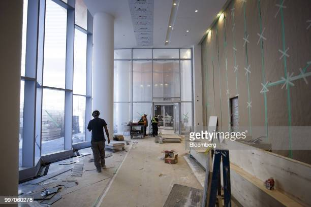 Workers stand in the lobby during construction of the GWL Realty Advisors Livmore luxury apartment building in Toronto Ontario Canada on Tuesday July...