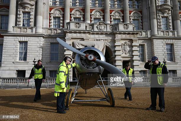 Workers stand next to a World War 1 Sopwith Snipe as it is assembled at Horse Guards Parade on March 30 2016 in London England The RAF Museum will...