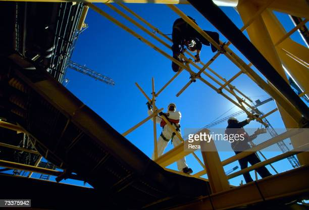 Workers stand on the Aramco offshore oil rig 'Marjan 2' in the Persian Gulf on March 2003 in Persian Gulf Saudi Arabia