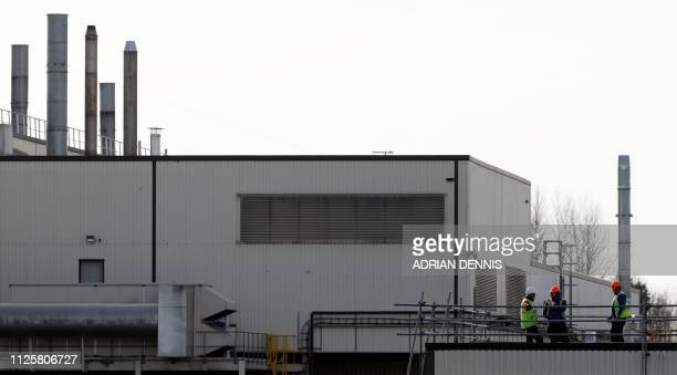 Workers stand on the roof of a builing at the Honda manufacturing plant in Swindon southwest England on February 19 2019 Honda will shut its UK plant...
