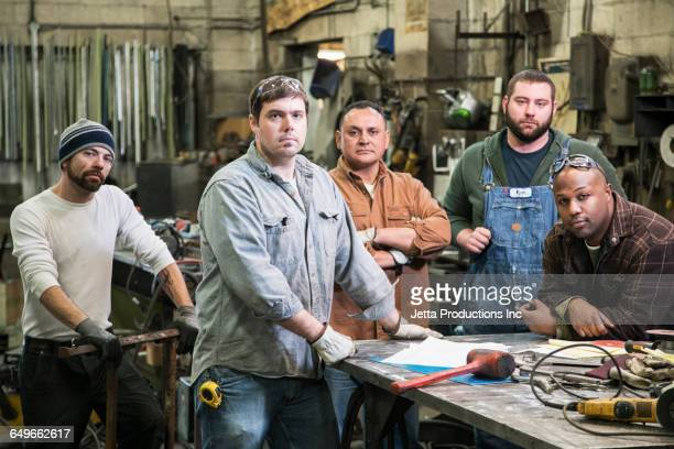 workers standing in workshop - jetta productions stock pictures, royalty-free photos & images