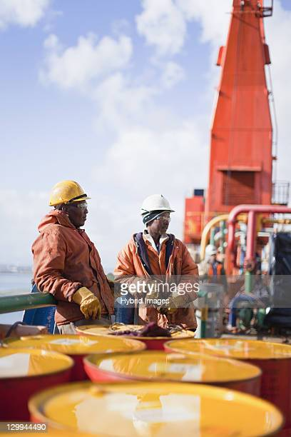 Workers standing on oil rig