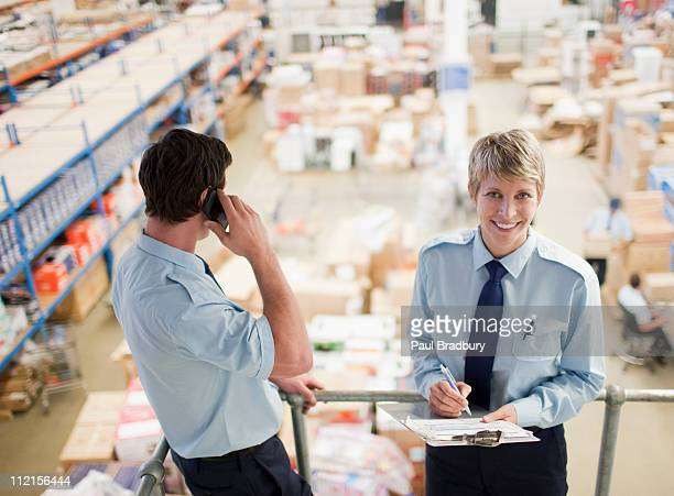 workers standing together above shipping area - post structure stock photos and pictures