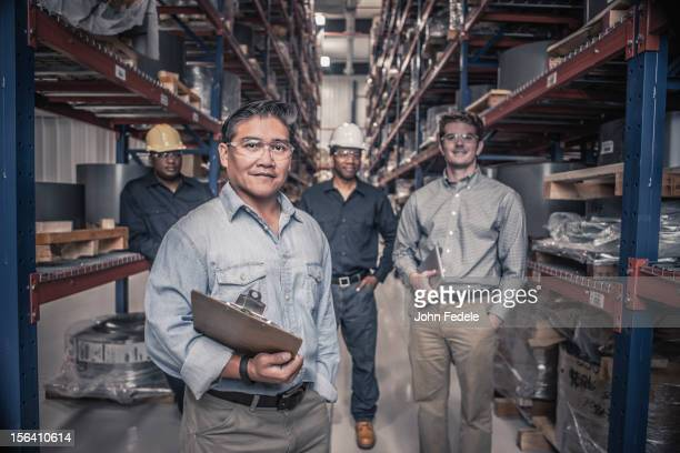 Workers standing together in factory
