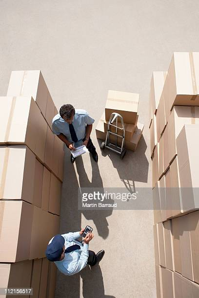 Workers standing with boxes