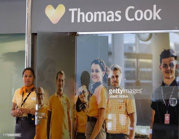 A workers stands in front of the office of the British travel group Thomas Cook at Son Sant Joan airport in Palma de Mallorca on September 24 2019...
