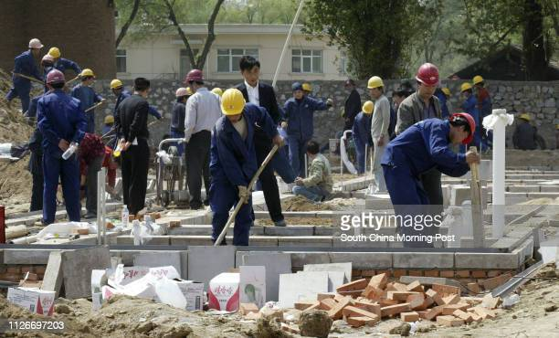 Workers start work on one of the new prefabricated hospital wards that are being built to house SARS patients at the Xiaotangshan hospital complex in...