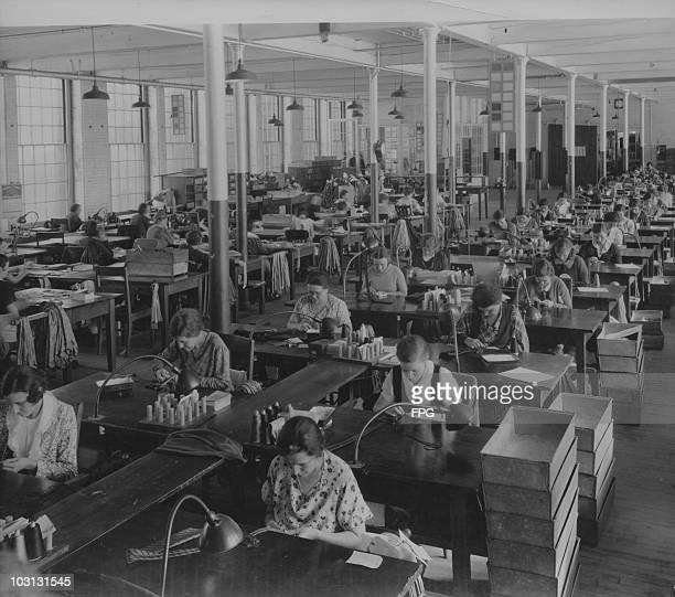 Workers stitching the centre seams of silk ties at a factory USA February 1934