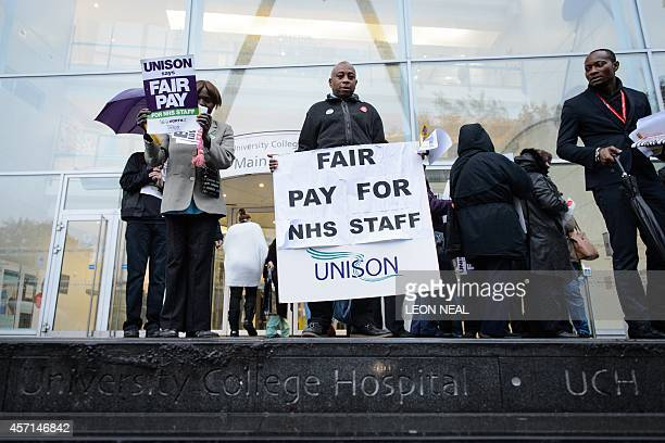 NHS workers strike outside University College Hospital in central London on October 2014 Workers in England's staterun National Health Service went...