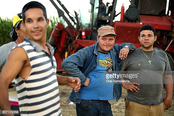 Workers take a break from harvesting sugar cane to refuel their harvesters and tally up their totals from the day December 1 2016 in Camaguey Cuba...