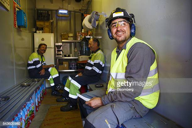 Workers take a break in the coffee room on the Casablanca oil platform operated by Repsol SA in the Mediterranean Sea off the coast of Tarragona...