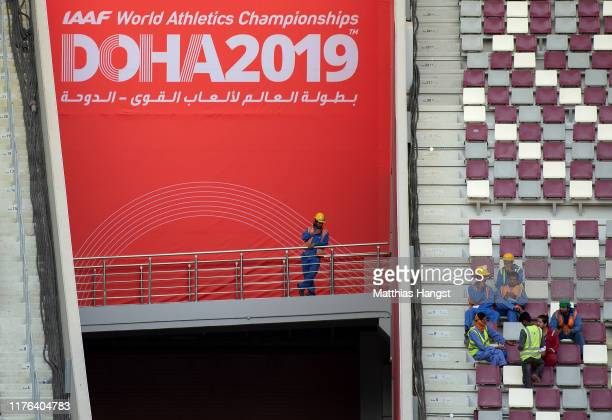 Workers take a break on the tribune of the Khalifa International Stadium prior to the 17th IAAF World Athletics Championships Doha 2019 at Khalifa...