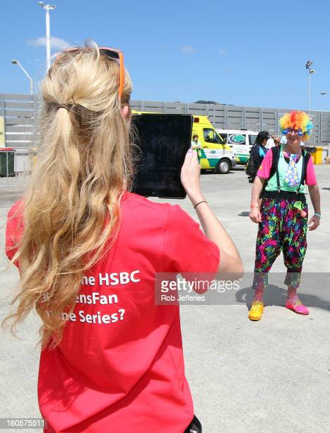 HSBC workers take a photo of public who have entered SevensFan of the Series competition during the Hertz Sevens Round four of the HSBC Sevens World...