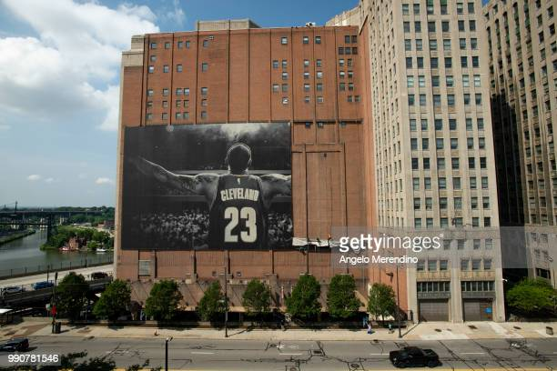 Workers take down the LeBron James banner from the Sherwin Williams building on the corner of Ontario and West Huron on July 3 2018 in Cleveland Ohio...
