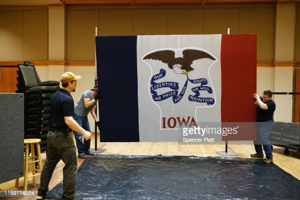 Workers take down the state flag after a campaign stop by presidential candidate Pete Buttigieg in Cedar Falls on January 15 2020 in Cedar Falls Iowa...