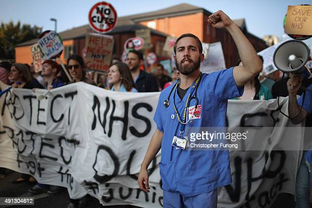 Workers take part in an anti-austerity protest during the first day of the Conservative Party Autumn Conference 2015 on October 4, 2015 in...