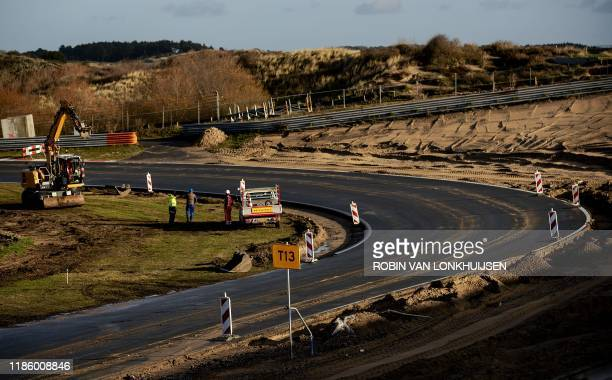 Workers take part in reconstruction operations on the motor racing circuit at Zandvoort on December 2 where the 2020 Formula 1 Dutch Grand Prix is...