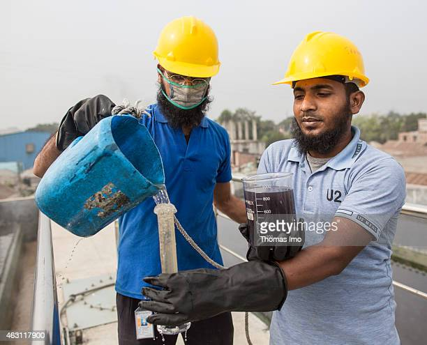 Workers taking a sample of water of the inhouse sewage treatment plant of the textile factory Zaber and Zubair Fabrics Ltd on December 08 2014 in...