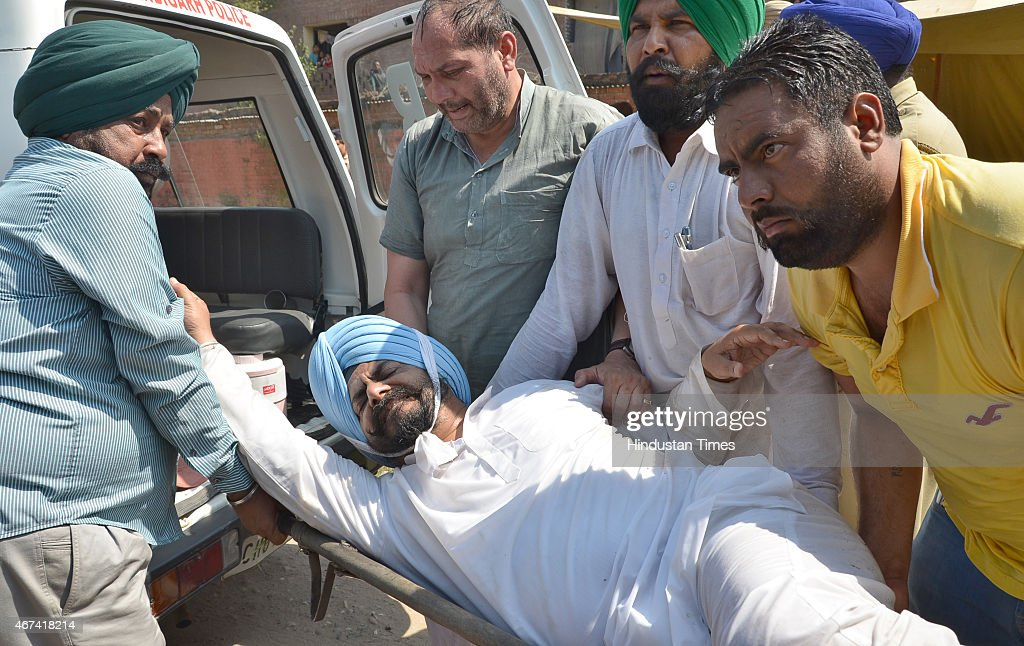 Workers taking Congress MLA Kuljit Singh Nagra who was injured in use of lathi charge and water cannon by Chandigarh police during their protest...