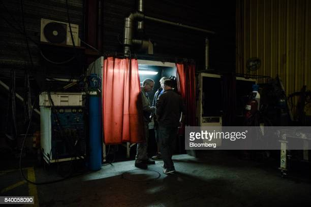 Workers talk in the GMS automobile parts factory in La Souterraine La Creuse region France on Monday July 24 2017 Even as President Emmanuel Macron...