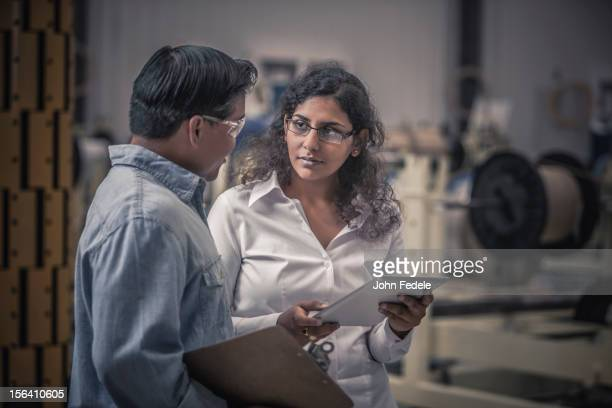 Workers talking in factory