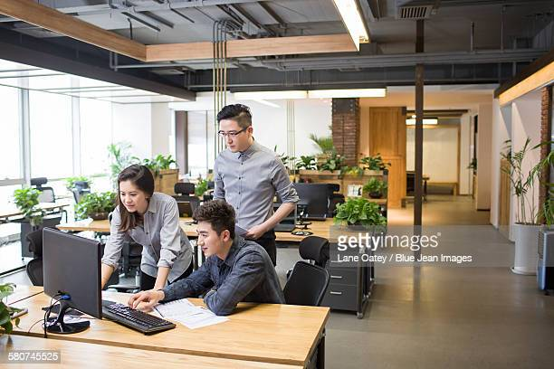 IT workers talking in office