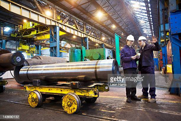workers talking in steel forge - metal industry stock pictures, royalty-free photos & images