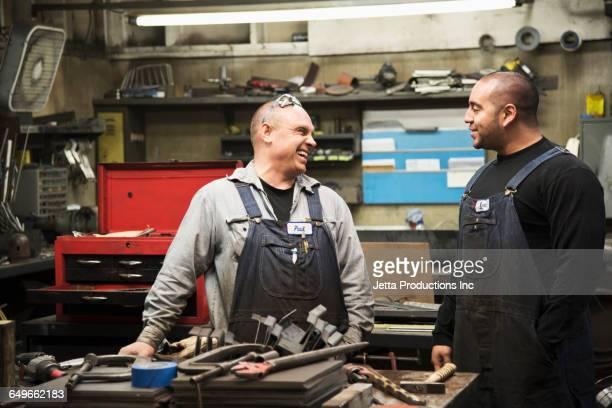 Workers talking in workshop