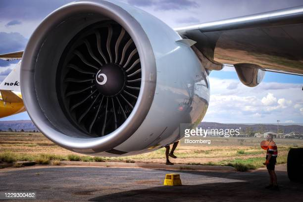 Workers tends to the engine of an aircraft during the induction process at the Asia Pacific Aircraft Storage Facility in Alice Springs, Northern...
