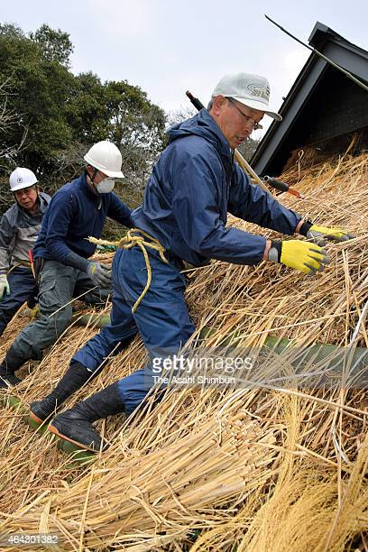 Workers thatch the roof of the Hirobumi Ito's birthplace on February 23 2015 in Hikari Yamaguchi Japan