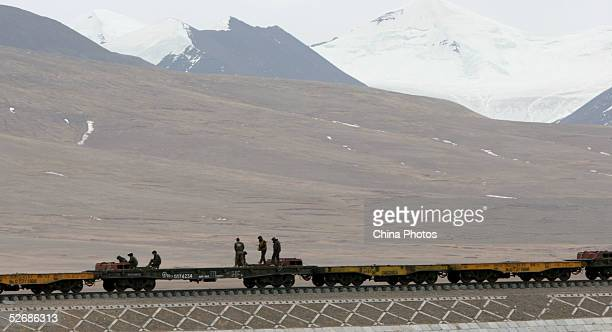 Workers toil at the construction site of the 2040km long QinghaiTibet Railway at an altitude of 4900 meters outside of Lhasa April 22 2005 in Amdo...