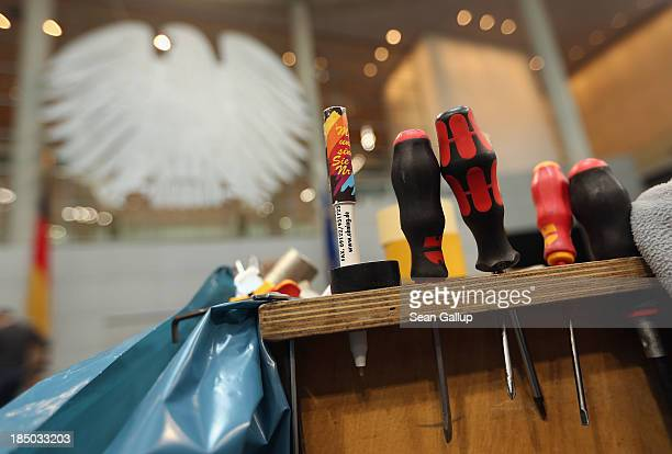 Workers' tools stand on a workbench in the plenary hall of the Bundestag while workers insatlled new desks and chairs on October 17, 2013 in Berlin,...