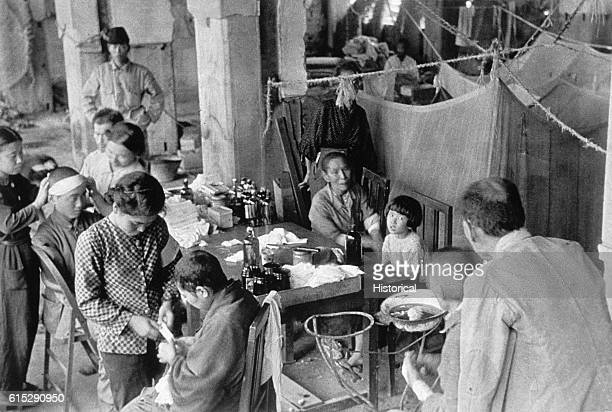 Workers treat patients at the Fukuromachi Relief Station who have been exposed to the radiation from the atomic bombs dropped on Japan in August 1945...