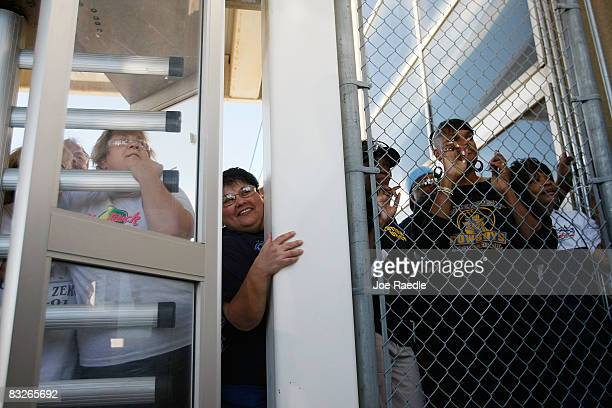 Workers try to get a glimpse of Democratic presidential nominee US Sen Barack Obama as he greets people near the main gate at the Toledo Machining...