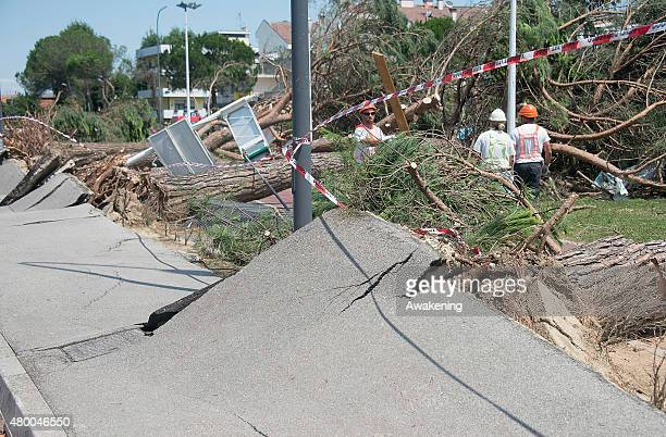 Workers try to restore power lines destroyed by falling trees on July 9 2015 in Venice Italy A tornado swept through the outskirts of Venice touching...