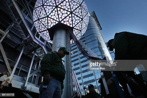 Workers uncoil wire during a test of the New Years Eve Ball December 30 2008 in New York City This year's ball is twelve feet in diameter twice that...