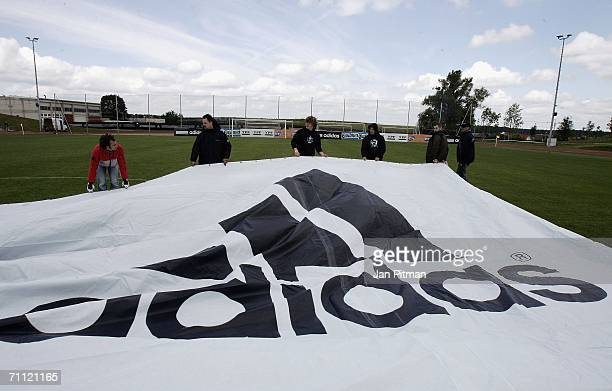 Workers unfold a 60 by 15 metre big poster of Lionel Messi of Argentina at the World of Sports Stadium on June 4 2006 in Herzogenaurach Germany