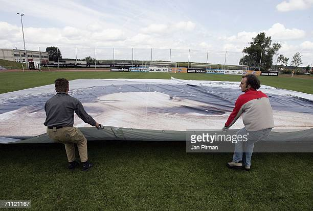 Workers unfold a 60 by 15 metre poster of Lionel Messi of Argentina at the World of Sports Stadium on June 4 2006 in Herzogenaurach Germany