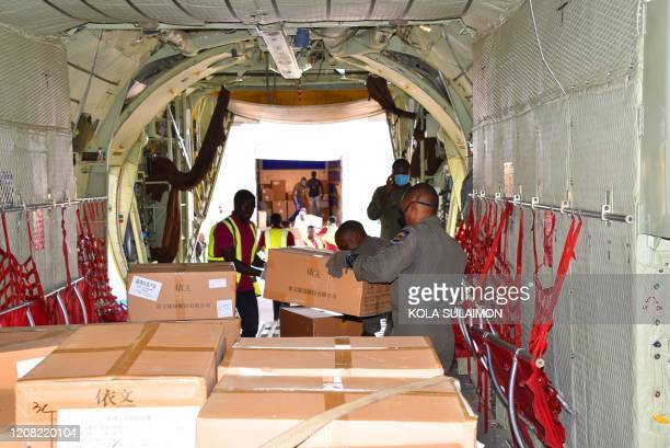 Workers unload a consignment of medical supplies donated by Chinese billionare Jack Ma to help deal with the COVID19 coronavirus impact after it...