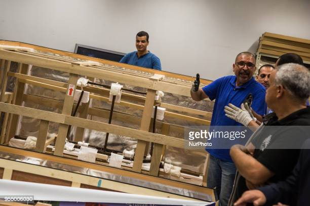 Workers unload boxes contaning pieces of the last chariot of Tutankhamun at the Grand Egyptian Museum Giza Egypt 05 May 2018 The sixth and last...