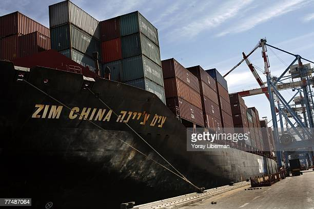 Workers unload containers off Zim China ship on March 07 2007, in the port of Haifa, Israel. Israel Corp. Ltd. Is a holding company owned by the...