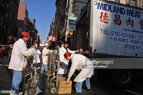 Workers Unload Meat Delivery In Chinatown New York November 19 2001