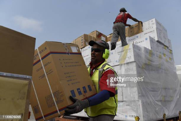 Workers unload medical supplies from China at Simon Bolivar International Airport in Maiquetia Venezuela on Friday March 29 2019 Chinese planes...
