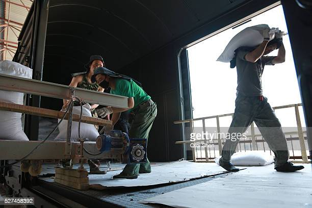 Workers unload potash from Russian at a train depot in Manzhouli Inner Mongolia China on 30 June 2012 Russian supplies much of its raw material trade...